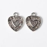 Hartje op hart antiek zilver