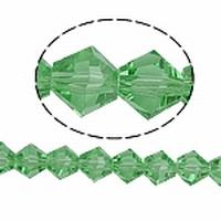 Kristal rond machinaal geslepen licht groen foto is bicoon