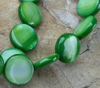 Rond plat schelp groen parelmoer
